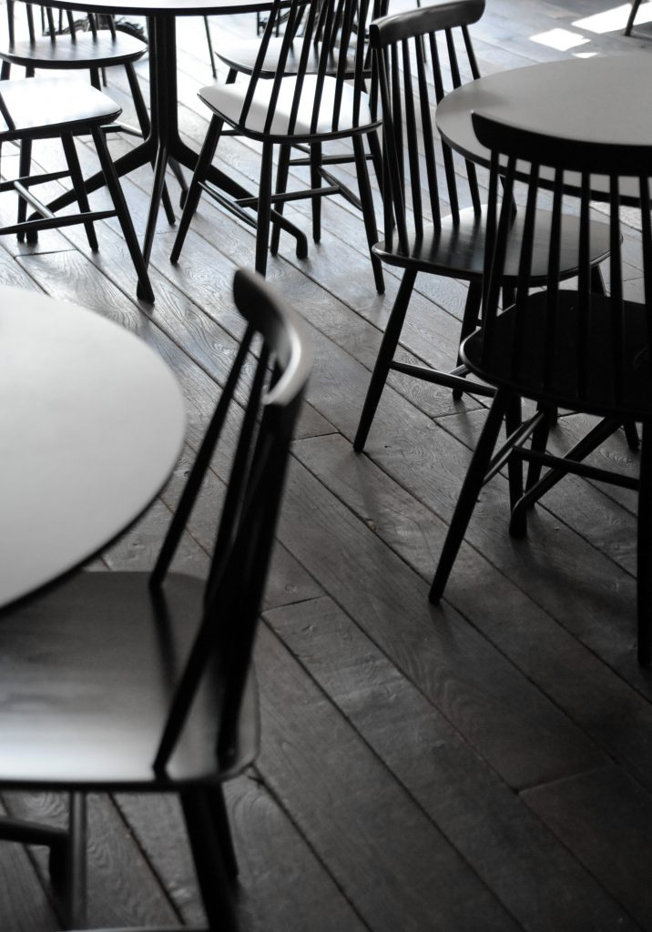 black chairs and tables on a black floor