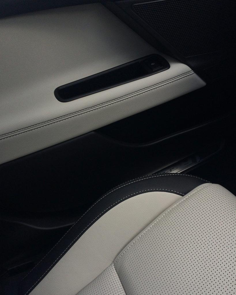 interior of jaguar xe car with pale seats