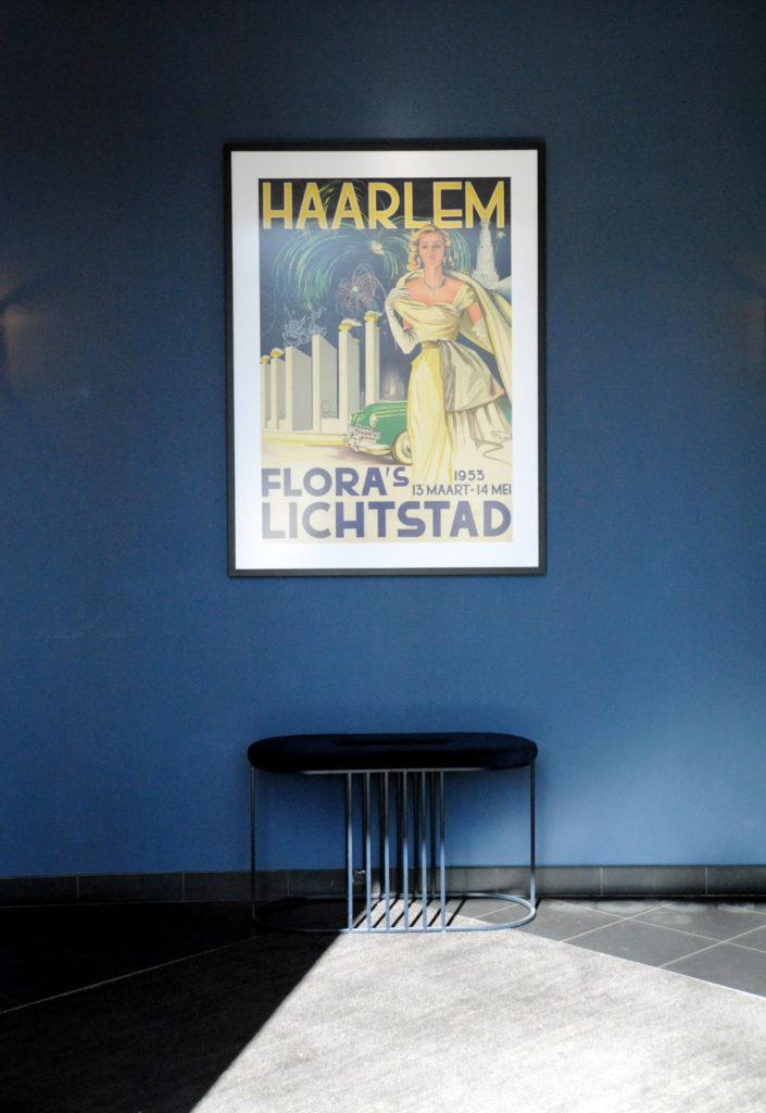 vintage poster in hotel lobby that reads Haarlem Flora's Lichtstad 1953 13 Maart - 14 Mei