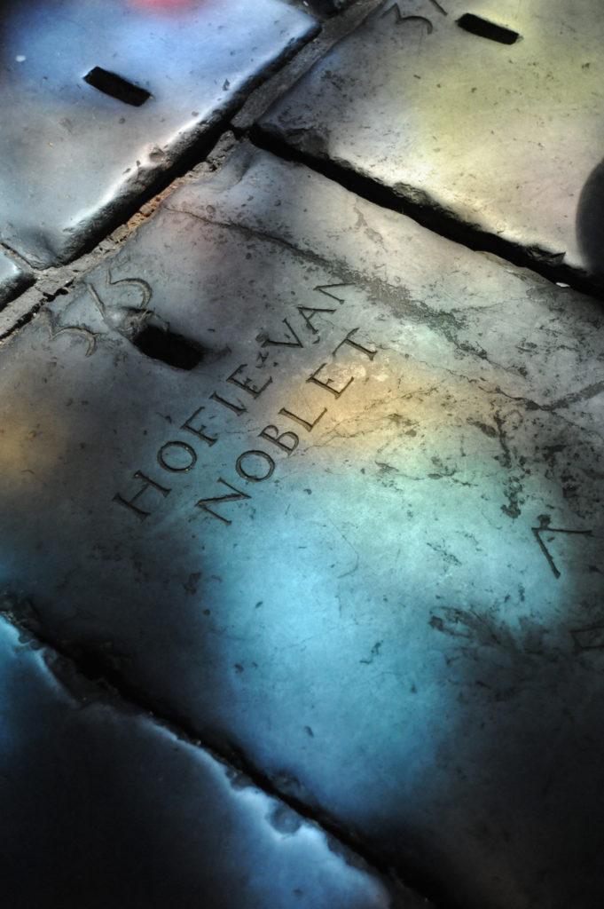 grave stone inside the church that is inscribed Hofie Van Noblet