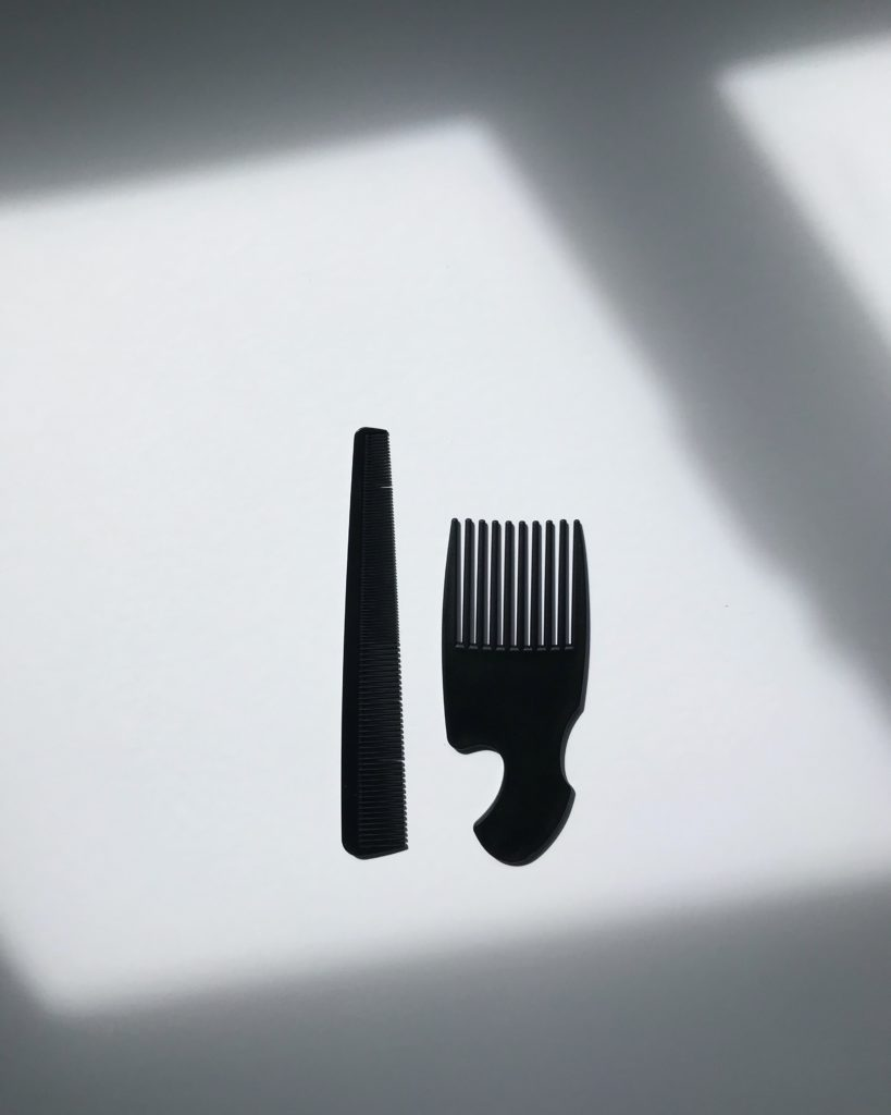 two black combs on a white background