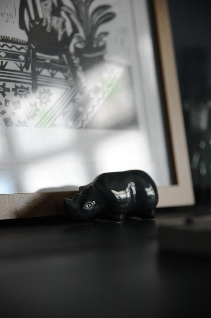 small rhino ornament on a shelf