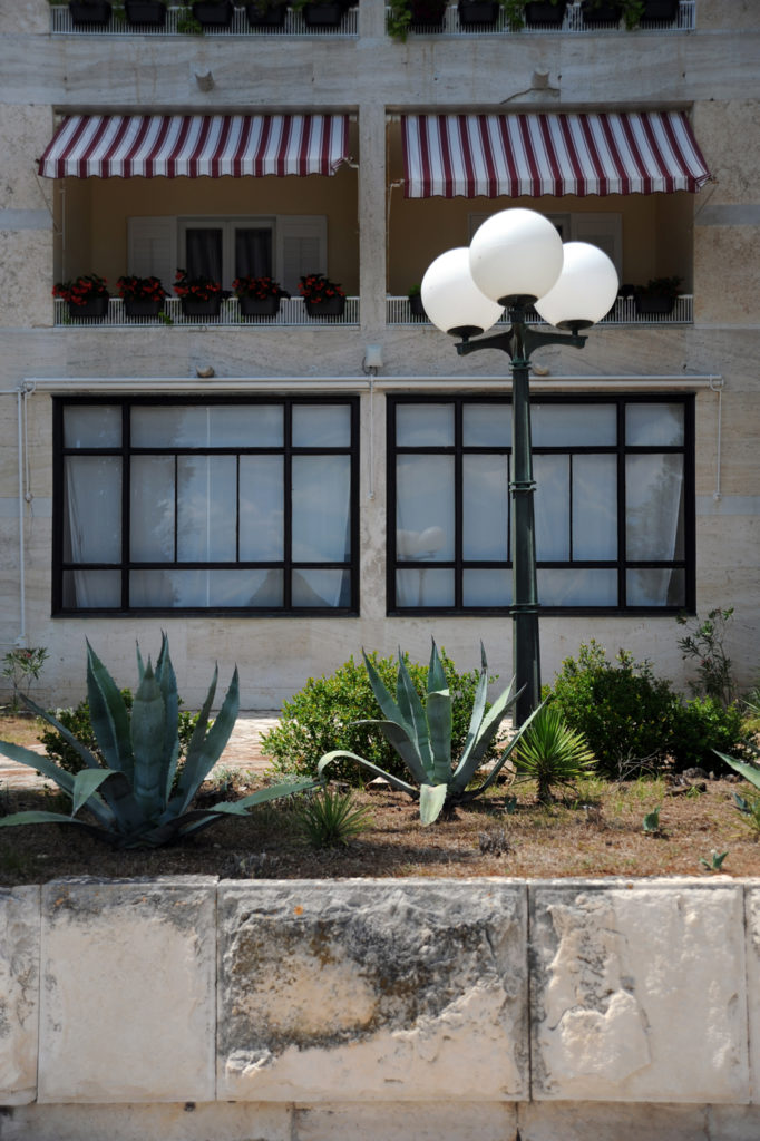 lamppost and aloe vera plants in front of building
