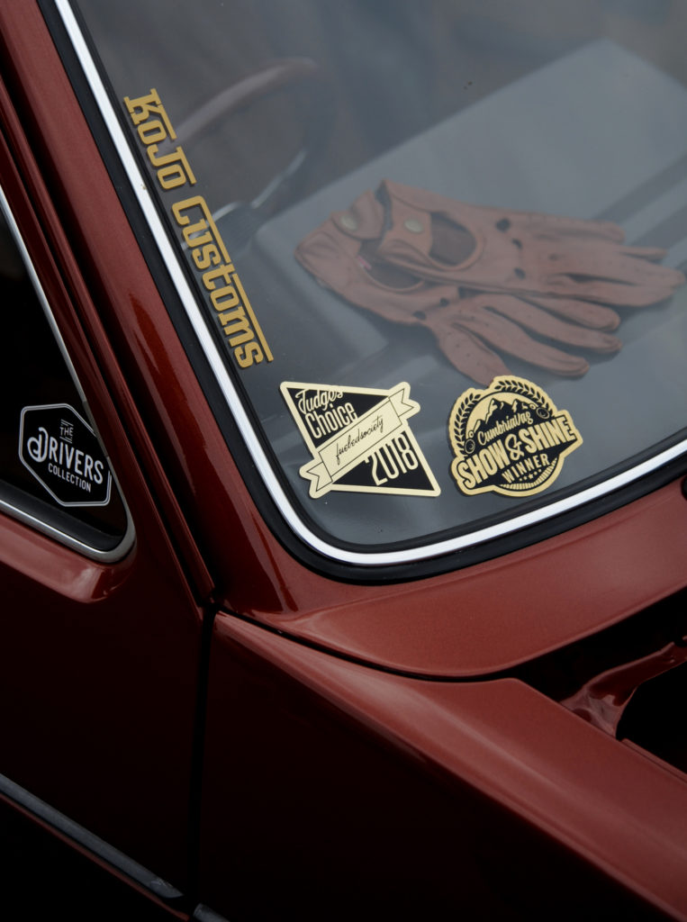 windscreen with gold award stickers on a custom painted canyon red volkswagen golf mk1